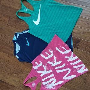 3 Nike tanks sm/med